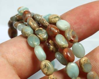Light Blue Jasper Faceted Oval Beads 9mm