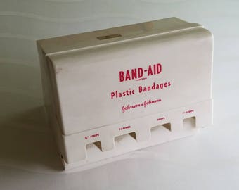VINTAGE Johnson & Johnson plastic bandage  Dispenser from Medical office from around 1960s or 70' s