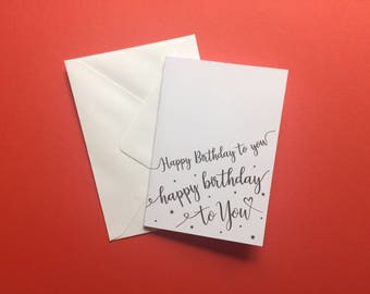 Happy birthday to you card black print white A6 card with envelope script font stars