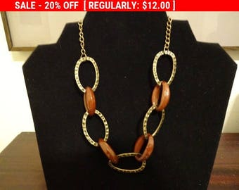 Additional 10 Dollar Coupon Inside Sophisticated gold tone and brown plastic link necklace