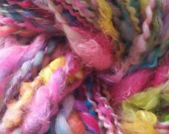 TASSEL skein of yarn spun to spinning wheel.
