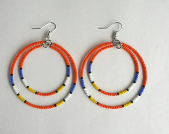 Handmade hoop earrings, orange earrings, orange bead earrings, African jewelry, beaded earrings