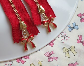 """Set of 2 Atsuko Matsuyama A-Two Closed End Zipper with Red Ribbon Bow Zipper Pull 