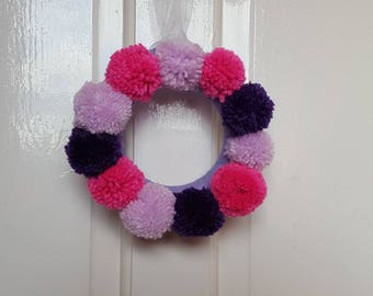 Small pink and purple pom pom wreath
