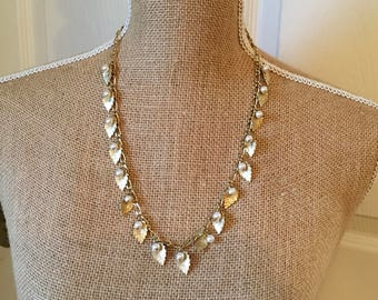 Faux pearl and gold tone necklace