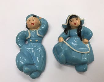 Vintage 1950's Dutch Boy and Girl Chalkware wall hangings