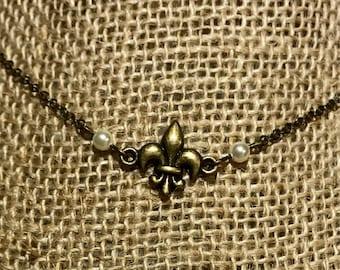 Antique bronze fluer de lis and pearl choker necklace