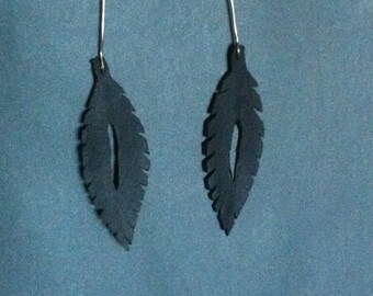 Black feather inner tube earrings