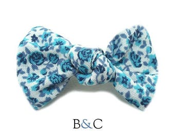 Hair bow tied Liberty Blue.