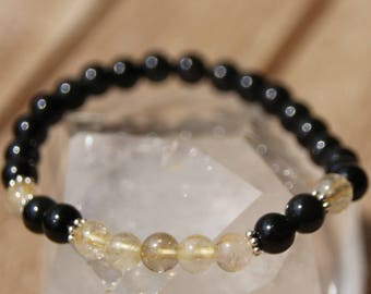 Obsidian and rutilated quartz bracelet