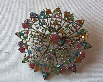Multi colored brooch, silver tone
