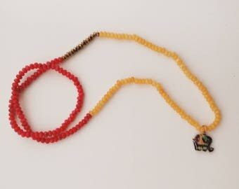 Yellow and Fuchsia birthstone necklace with elephant and gemstone jewelry