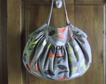 Reversible hand bag with print sheets