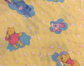 "Winnie the Pooh, sleeping on yellow by Springs Industries, 43-44"" wide, 100% cotton By the half yard"