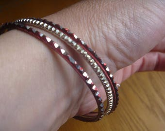 three small stacking bangles, vintage red and silver stacking bangles