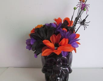 Purple Glass Skull filled with Halloween Silk Flower Arrangment, featuring a Spider Pick