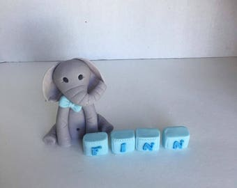 Fondant baby elephant with name cake topper