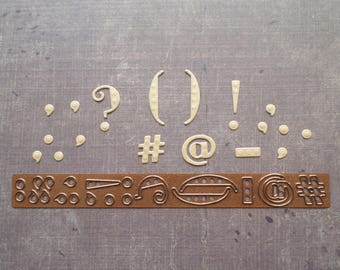 Die cut punctuation text dots Creative