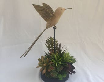Succulents with wooden bird
