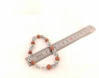 alluminium bracelet with sun stone