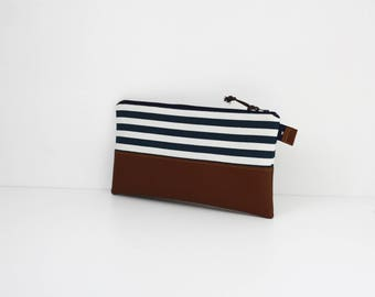 Flat clutch in faux leather and striped cotton