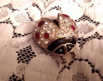 Ladybird brooch with red glass,diamante crystals on black enamel