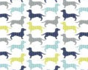 Camelot Fabric's Dog Gone It scatterd  multi colored dachshunds in blue, gray, navy,and green herringbone