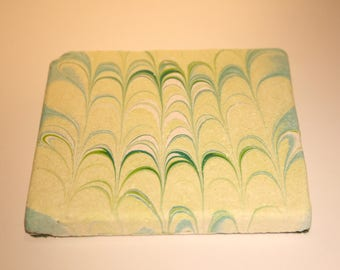 Hand marbled stone tile with nonpareil design.(007)