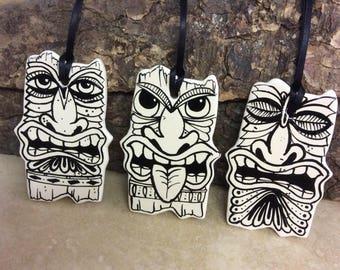Set of three ceramic Tiki head decorations