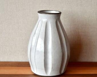 White hand-carved bud vase