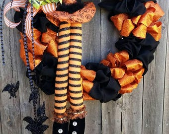 Halloween Wreath with witches feet, hat and bats!
