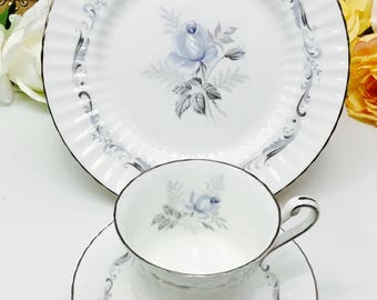 "Paragon ""Morning Rose"" teacup, saucer and dessert plate trio."