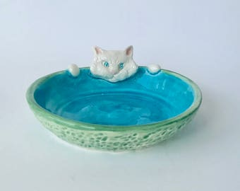 Handmade White Cat with Paws in a Blue and Green Dish