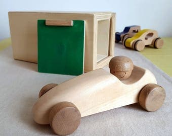 With his garage - man toy race car