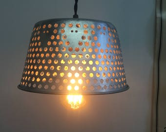 Vintage Industrial metal basket repurposed into a hanging lamp
