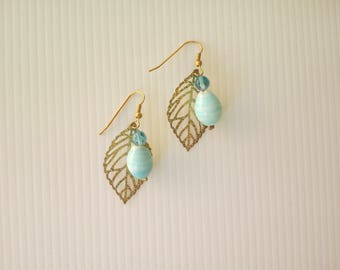 Earrings with golden leaves
