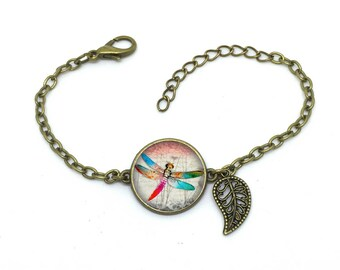 """Bracelet """" libellule """", image sous cabochon résine ,monture couleur bronze,ref bN 101"""