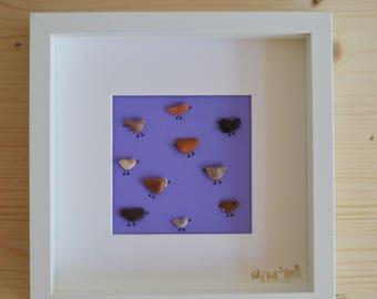 Beach pebble birds framed art