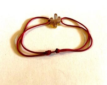Fuchsia and cactus color cord bracelet gold