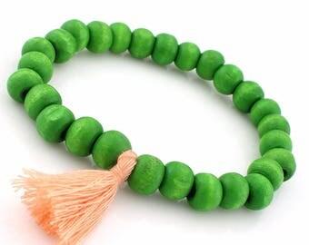 Orange boho wood bracelet / / / green salmon tassel & wood beads