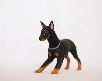 Doberman pinscher dog figurine