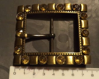 rectangular belt buckle in metal with large red rhinestones