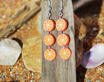 in the shape of oranges sliced fimo earrings
