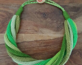 Handmade Knitted necklace / scarf in shades of green.