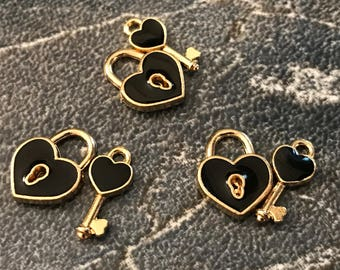 3 sets of black enamel and gold tone heart shaped lock and key charms