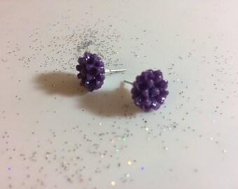 Purple flower earrings.