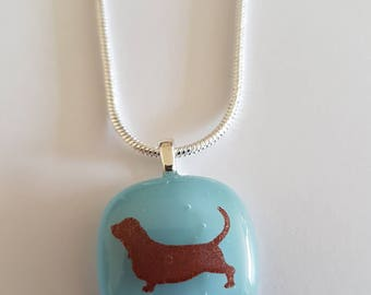 Fused glass pendant with Basset Hound silhouette.