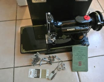 Singer 221K Featherweight Sewing Machine with attachments and Instruction Manual