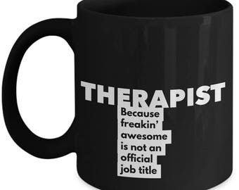 Therapist because freakin' awesome is not an official job title - Unique Gift Black Coffee Mug