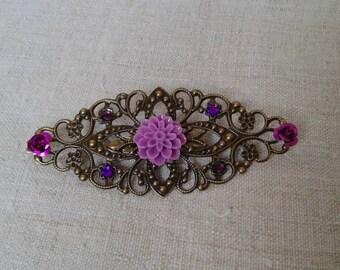 pretty purple flower and rhinestone brooch